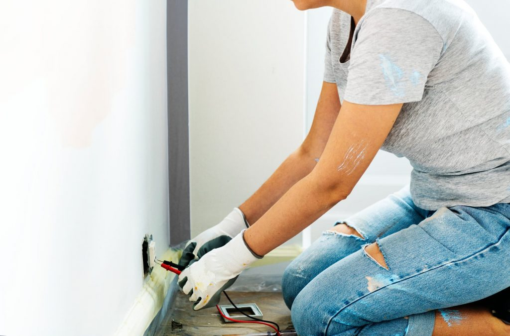 person holding multimeter beside white painted wall 1024x675 - 4 Professionals You'll Hire for a Perfect Kitchen Renovation